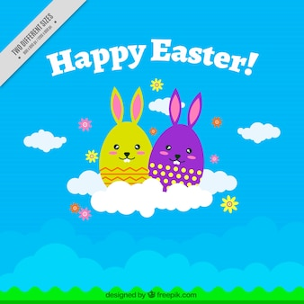 Blue background of easter bunnies on a cloud
