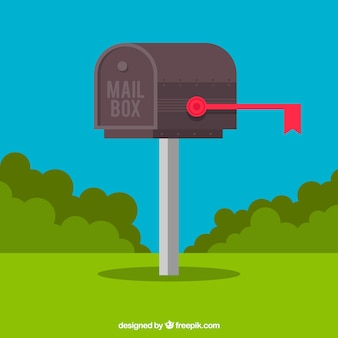Blue background of mailbox with shrubs