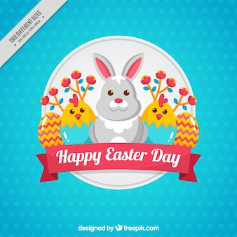 Blue background with cute rabbit and two chicks for easter day