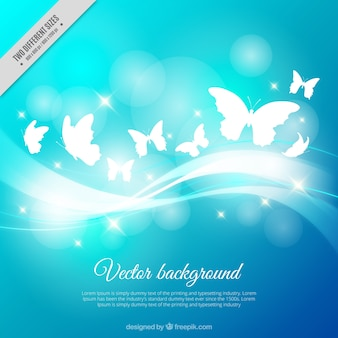 Blue background with shiny butterflies and wavy lines