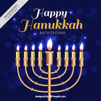 Blue bokeh background with candelabra for hanukkah