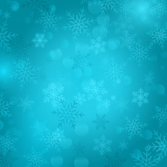 Blue bokeh background with snowflakes