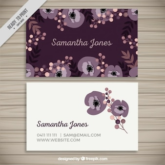 Blue business card with floral elements