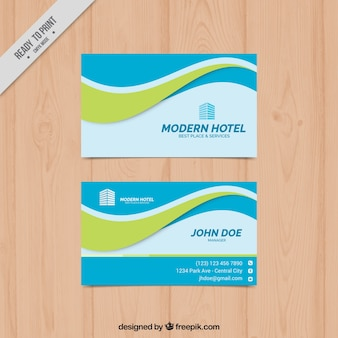 Blue business card with green wavy shape