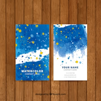 Blue business card with watercolor orange stains