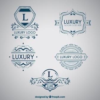 Blue capital letter logos