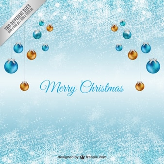 Blue christmas background with hanging baubles
