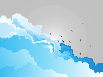 blue clouds and silhouette birds
