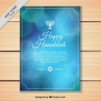 Blue hanukkah greeting card with bokeh effect