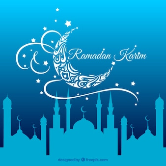 Blue ramadan background with a mosque silhouettes