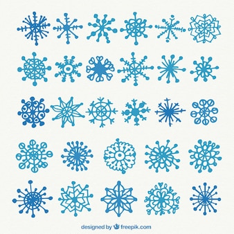 Blue snowflakes collection in hand drawn style