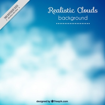 Blurred background of sky with white clouds