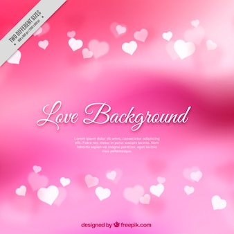 Blurred pink background with hearts