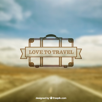 Blurred road landscape background with a hand drawn suitcase