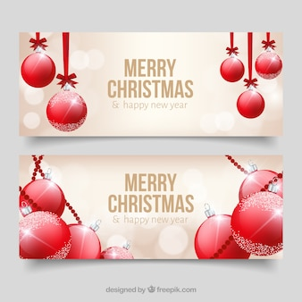 Bokeh banners with red christmas balls