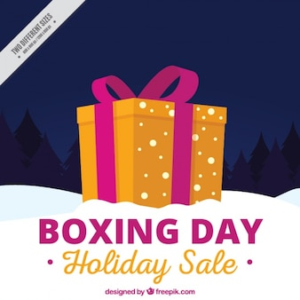 Boxing day background with orange gift and snow