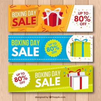 Boxing day banners with gifts and confetti in flat design