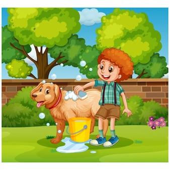 Boy washing dog