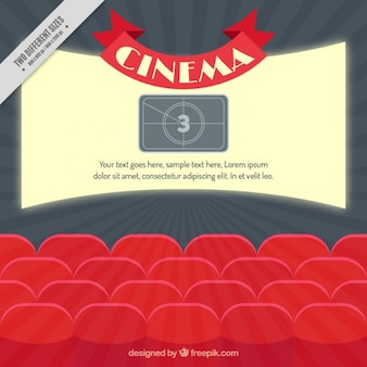Bright cinema screen with red armchairs