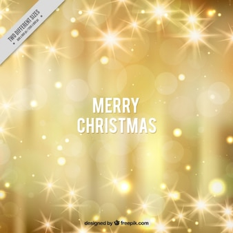 Bright golden bokeh background of merry christmas