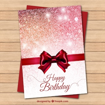 Bright red birthday card with a bow
