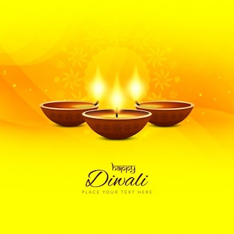 Bright yellow background with three candles for diwali
