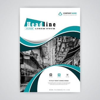 Brochure with blue wavy shapes and buildings