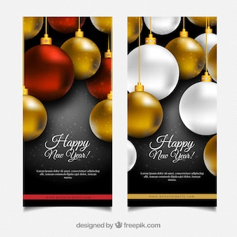 Brochures of new year with golden baubles