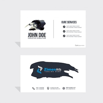 Business card with a black paint stain