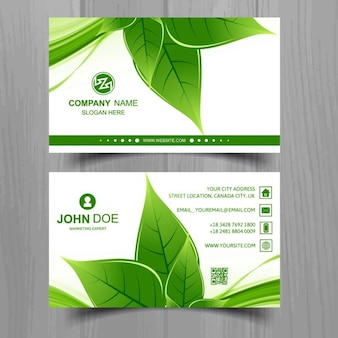 Business card with a green leaf