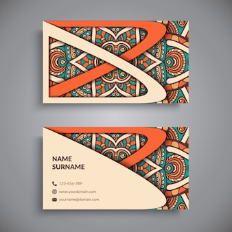 Business card with a mandala and orange shapes