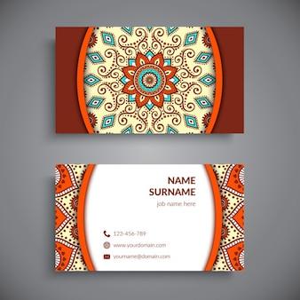 Business card with a mandala, warm tones