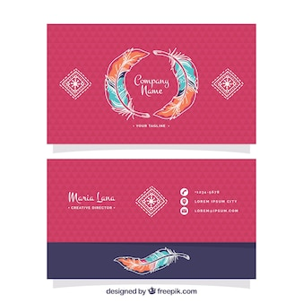 Business card with colored feathers