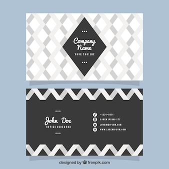 Business card with gray geometric shapes