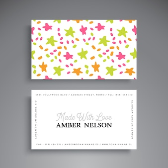 Business card with hand drawn stars and dots