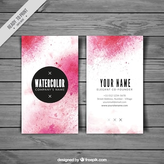Business card with pink watercolor stains