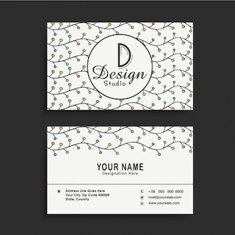 Business card with wavy lines and color dots