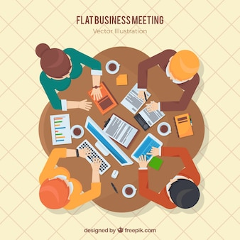 Business meeting at a table in top view