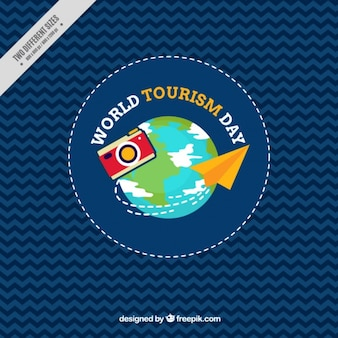Camera and paper airplane with earth background