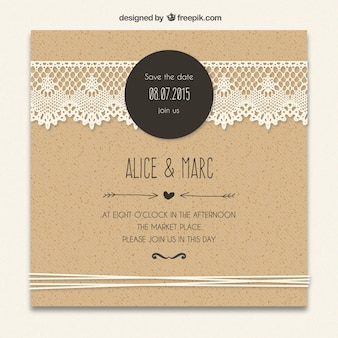 Cardboard wedding invitation with lacy decoration