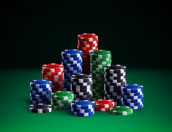 Casino chips isolated on green background