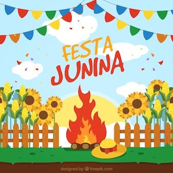 Celebrating festa junina around the bonfire background