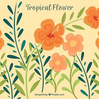 子どもの手は熱帯の花の背景を描いた