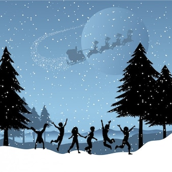 Children playing on the snow christmas background