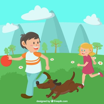 Children playing with dog at a field