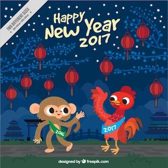 猿とオンドリと中国の新年の背景