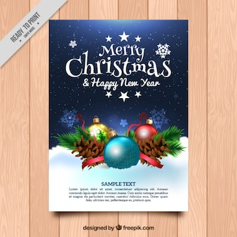 Christmas and new year greeting with realistic ornaments