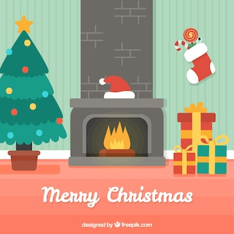 Christmas background with fireplace and gifts in flat design