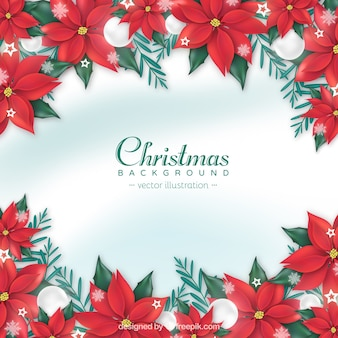 Christmas background with realistic red flowers