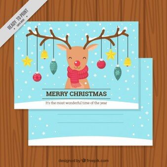 Christmas card of smiling reindeer with baubles